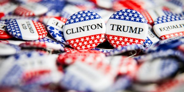 La Habra, United States - July 8, 2016: Close up of Vote election buttons, with red, white, blue and stars and stripes. Hillary Clinton is the democrat candidate and Donald Trump is the republican candidate for President of the United States